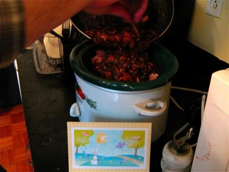 Pouring sauce over pork